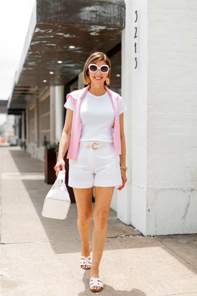 Shopping in the summer in all white Gap shorts and tee shirt