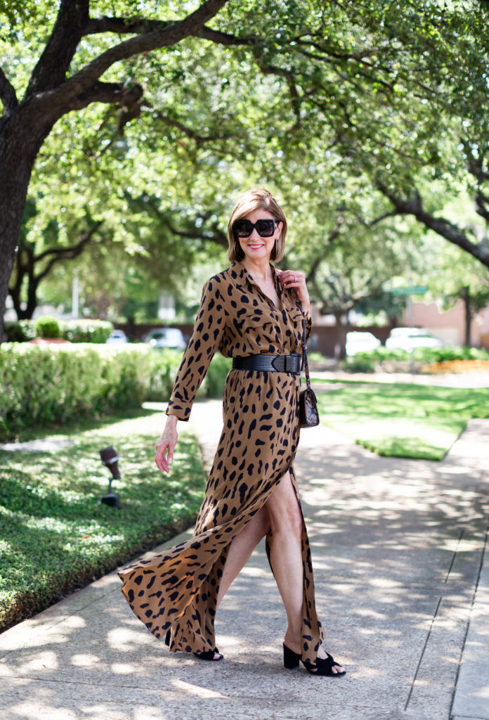 Over 50 fashion blogger in silk animal print maxi dress