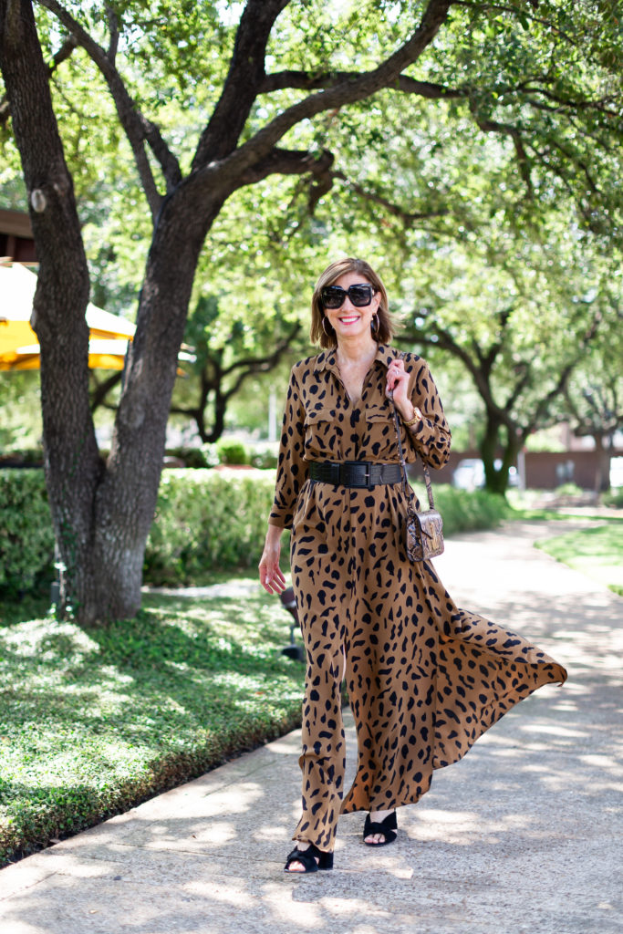 Over 50 blogger wearing animal print maxi dress