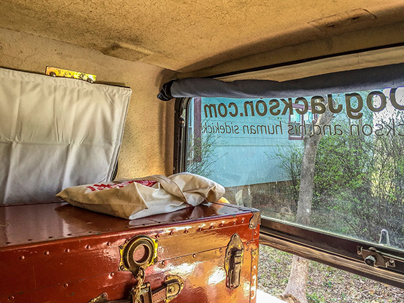 The curtain stowed from the back of the camper.