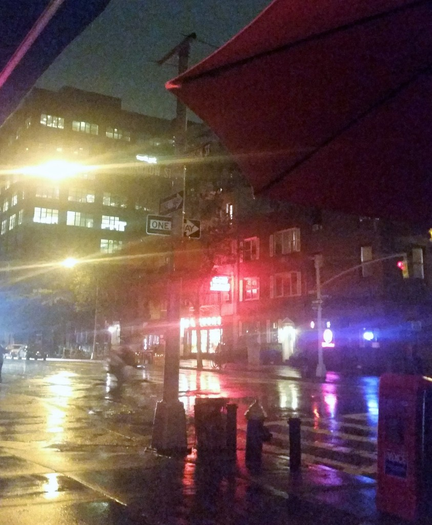 Rainy night view from a sidewalk table at Oscar's Place on Hudson Street.