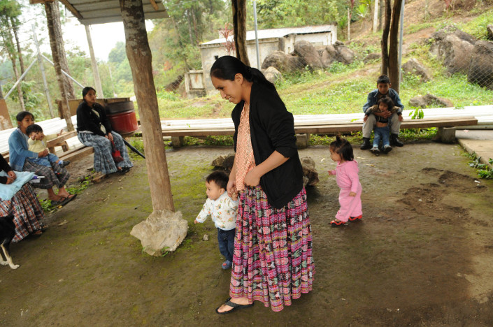 An indigenous Mayan woman leaves a health centre in rural Guatemala, where she has just had her children immunized.