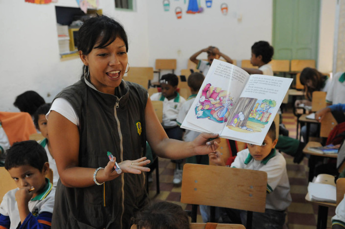 A first-grade teacher reads to her students in Medellín, Colombia.