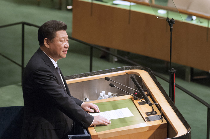 Close-up photo of Chinese President Xi Jinping speaking at the podium of the United Nations General Assembly.