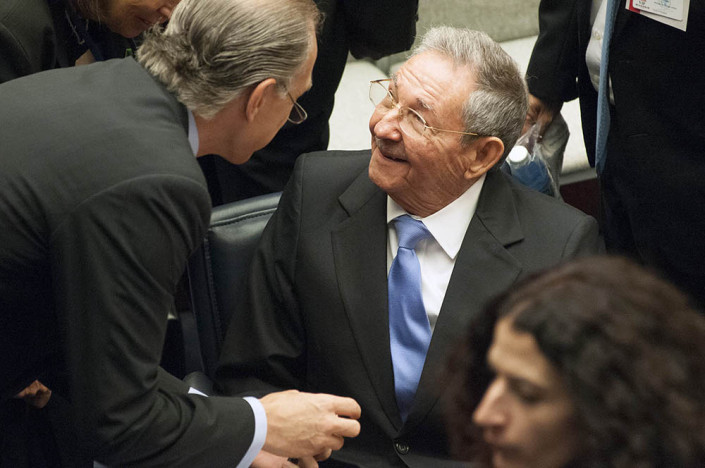 Cuban President Raul Castro smiles at a fellow diplomat as they chat at the UN.