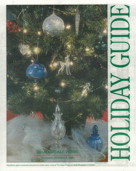Newspaper holiday guide featuring a Christmas tree and handblown glass ornaments.