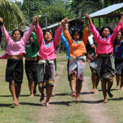 Indigenous Shipibo Conibo women from Nuevo Saposoa in rural Peru, do a welcome dance for visitors to their community.