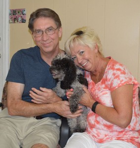 Popper with his new mom and dad!