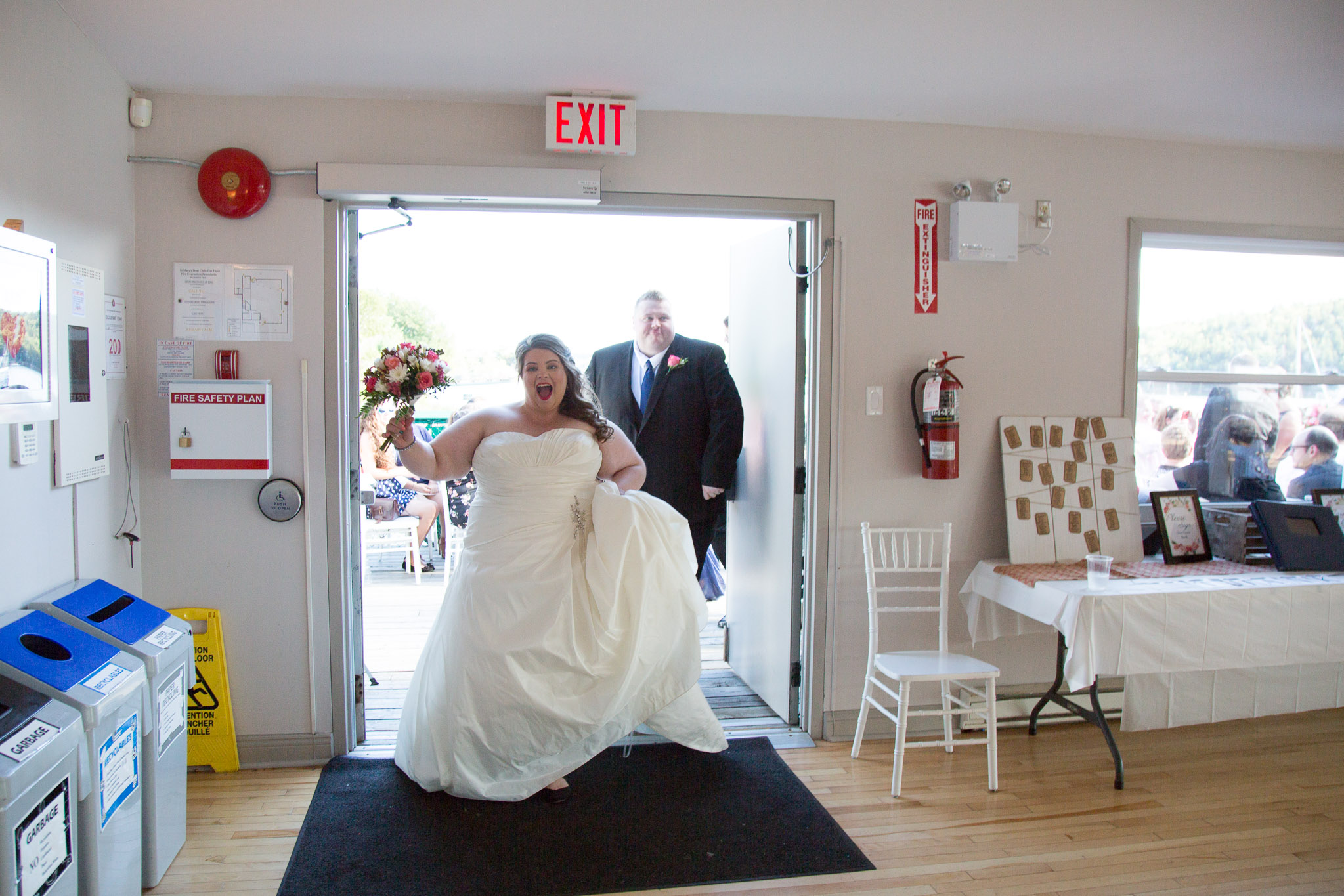 Image of bride and groom entering venue at Saint Mary's boat club