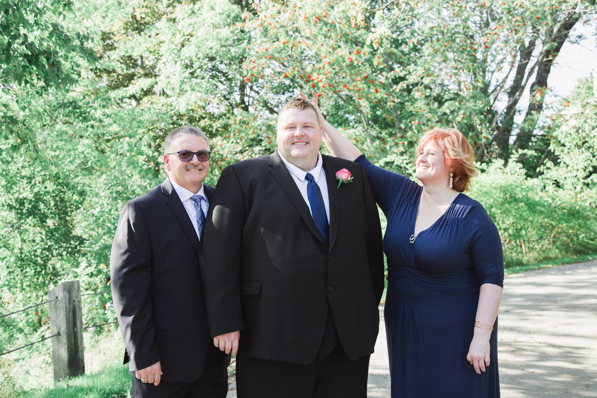 Image of groom and his parents posing
