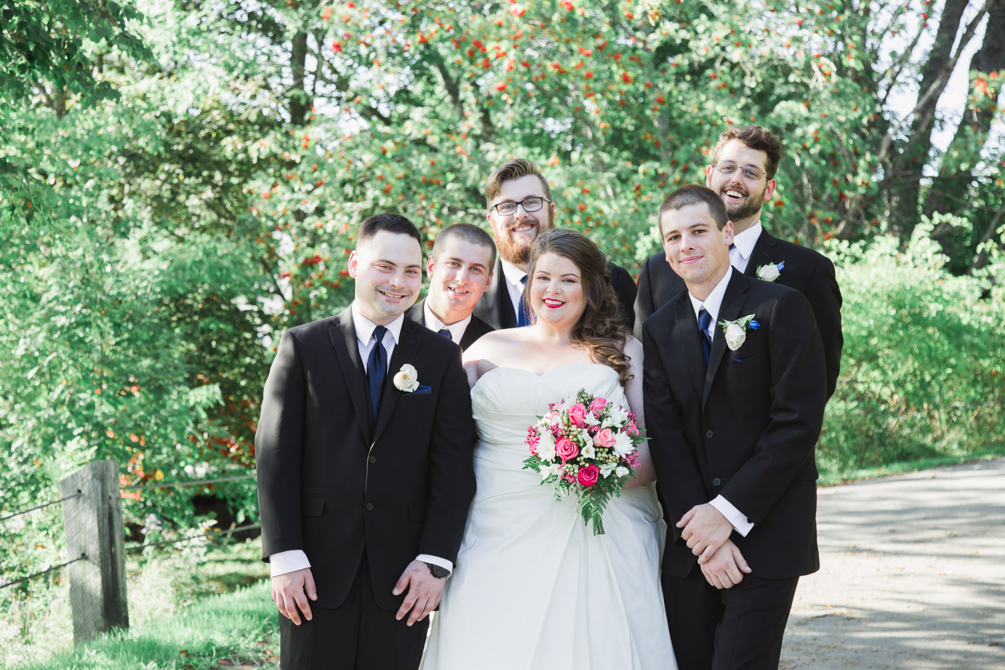 Image of bride posing with groomsmen party