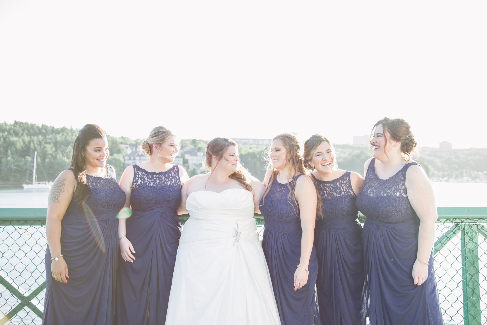 Image of bride and bridesmaids laughing during wedding photography session