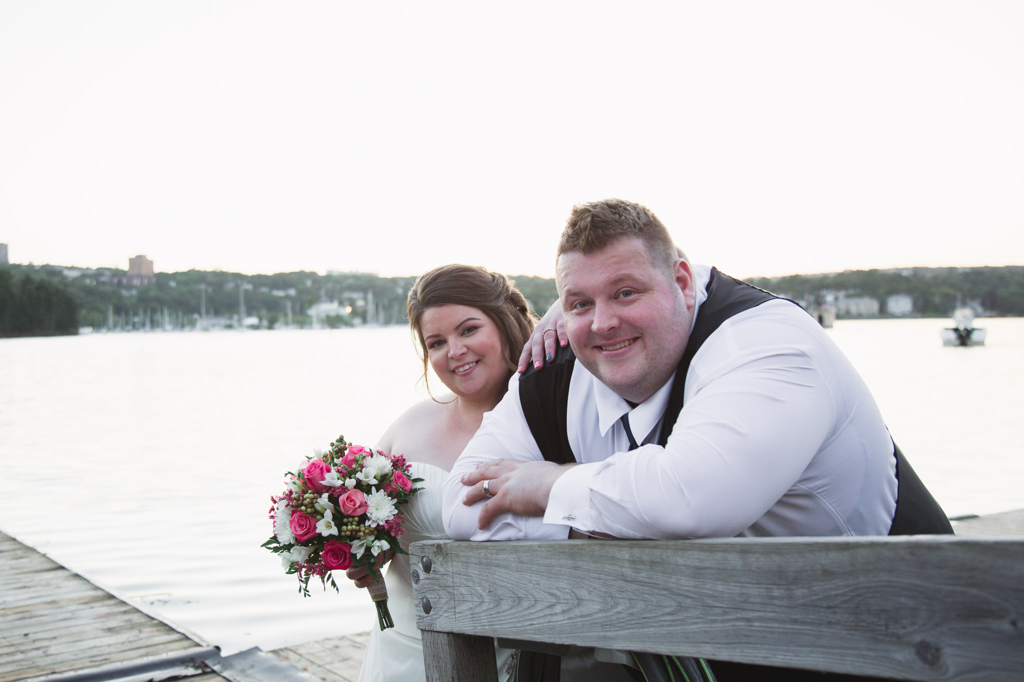 Picture of groom and bride looking at the camera at Saint Mary's boat club