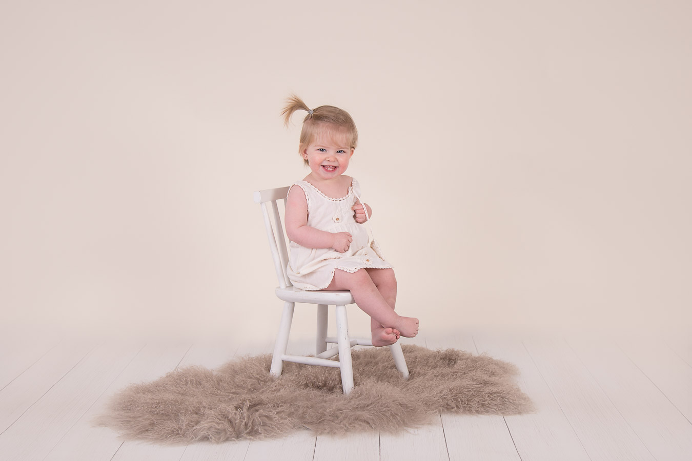 Image of girl siting on the chair from classic children session from Halifax Family Photographer