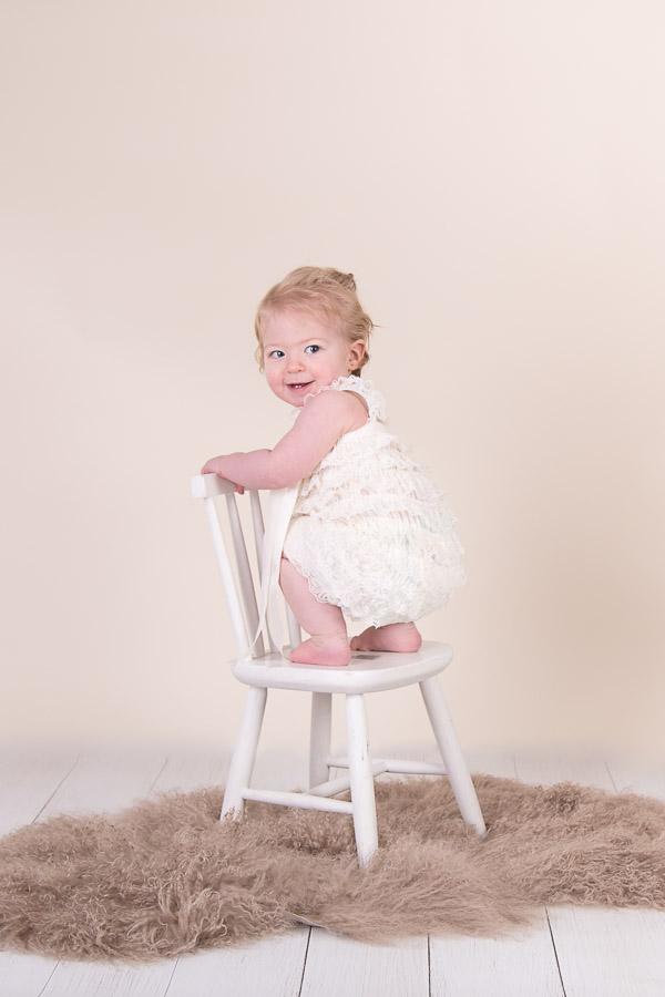 Image of girl standing on the chair from classic children session from Halifax Family Photographer
