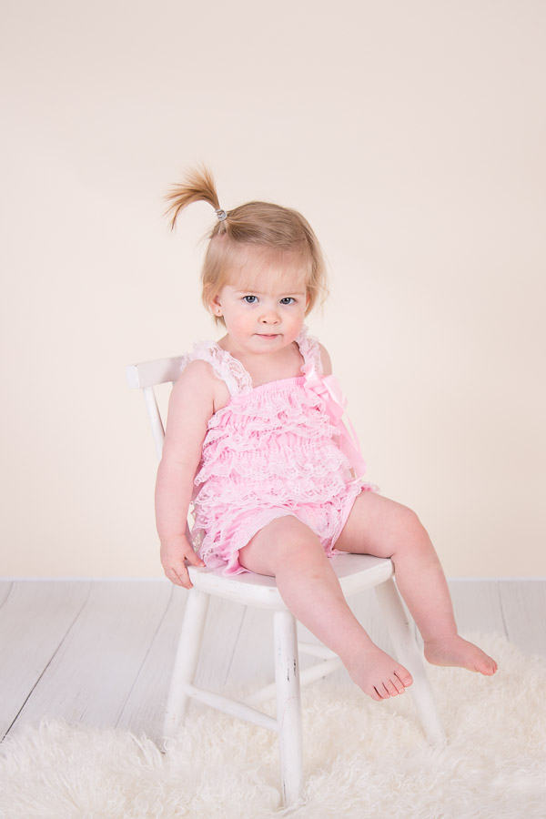 Image of girl sitting on the chair from classic children session from Halifax Family Photographer
