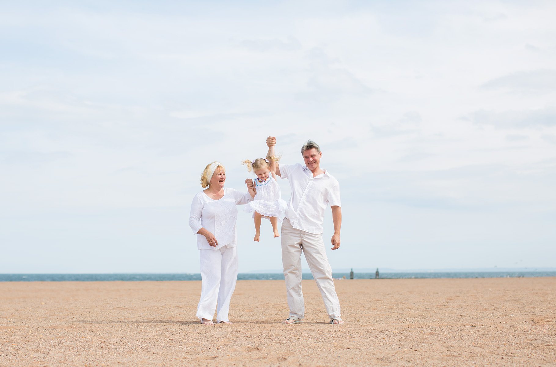 Three people during lifestyle session at the beach