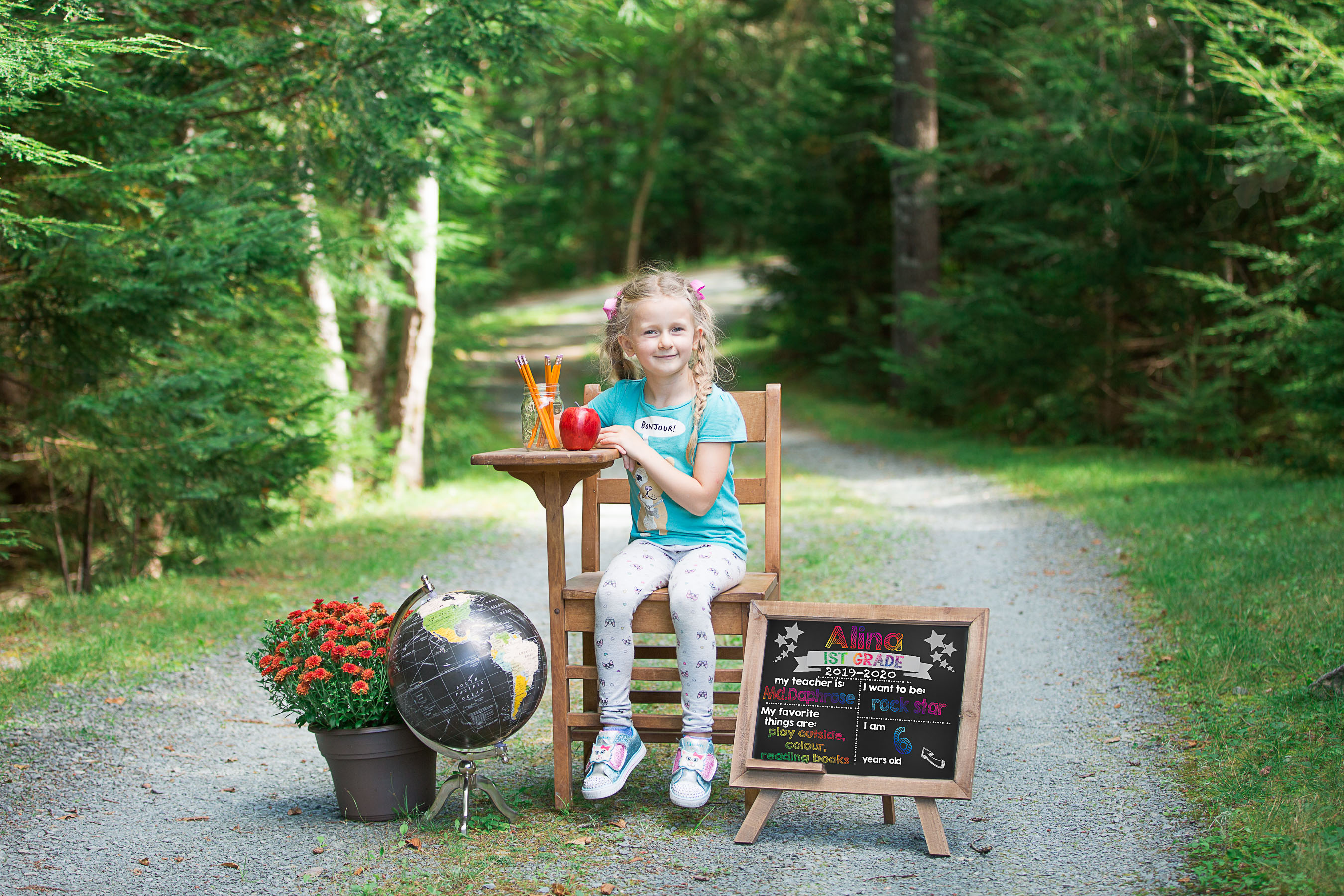 Image of girl holding first day of school sign