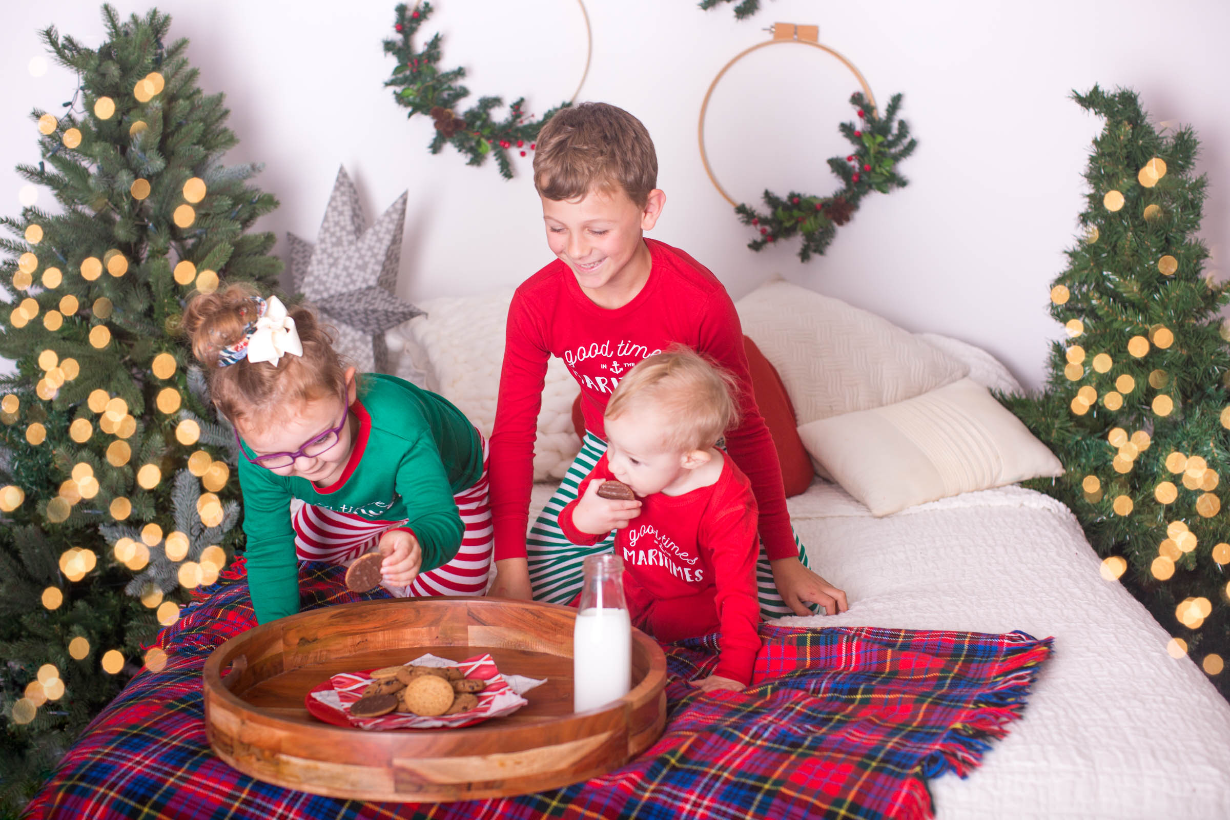 Image of 3 children choosing cookies off the tray