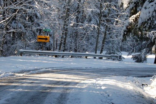 Icy_Road_with_Snow_and_Sign_by_happeningstock