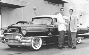 Carl Perkins and Sam Phillips with a 1956 Coupe De Ville at Southern Motors in Memphis - ca. 1956