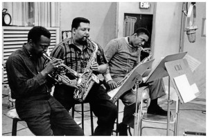 """Miles Davis, Julian Adderley and John Coltrane. Cannonball, with tenor saxophonist John Coltrane, rejuvenated Davis's group and together they created a fresh sound that created a stir in the jazz world. Adderley appeared with Davis on many notable recordings in the late 1950s, including Milestones and Porgy and Bess, in which Adderley can be heard on the songs """"Buzzard Song,"""" """"Fishermen, Strawberry and Devil Crab,"""" and """"Summertime."""""""