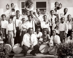 """Dillard High School has been recognized for its premier music and dance programs. Here, band director George A. Dean poses with the first band in the school's history (1946). Two years later, Dean was succeeded by legendary saxophonist Julian Edwin """"Cannonball"""" Adderley."""