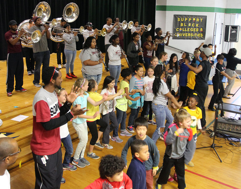 CW_Estes_students_clapping_with_band.jpg?time=1579890043