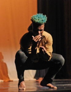 "Travis Simmons ""feeding"" himself during the Dance Group's routine to ""Feeding Time."" Photo by Tia Mitchell/Echo A&E editor"