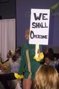 Ganzy 1960's inspired green dress, paying homage to the Civil Rights Movement. Photo by Keyandra Cotton/Echo Photo Editor