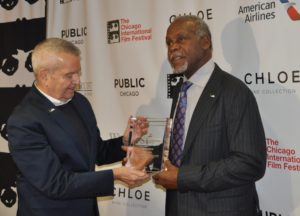 Danny Glover accepts the Visionary Award from Cinema Chicago founder and artistic director Michael Kutza.