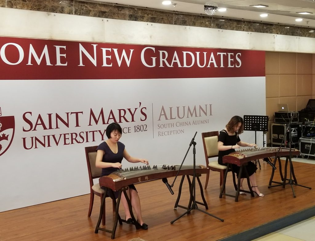 A performance of Chinese musical instrument by our new alumni