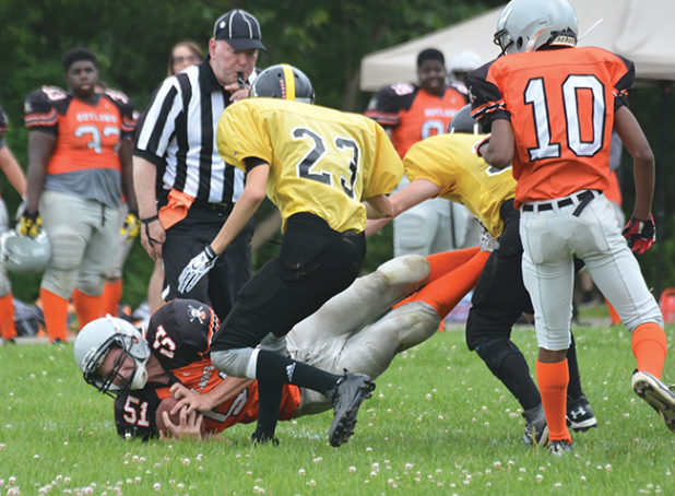Orangeville Outlaws Junior Varsity player, Jordan Payne, dives across the goal line during the fourth quarter of Sunday's (July 23) game against the TNT Express at Westside Secondary School in Orangeville. Payne scored the only Orangeville TD of the game. The Outlaws season is now over. This game ended with a 38-6 loss for the Outlaws.