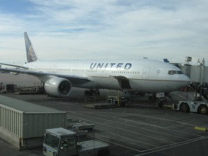A United Airlines Boeing 777 at Denver International Airport.