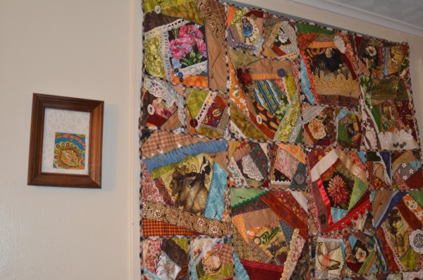 Steampunk crazy quilt hanging on wall