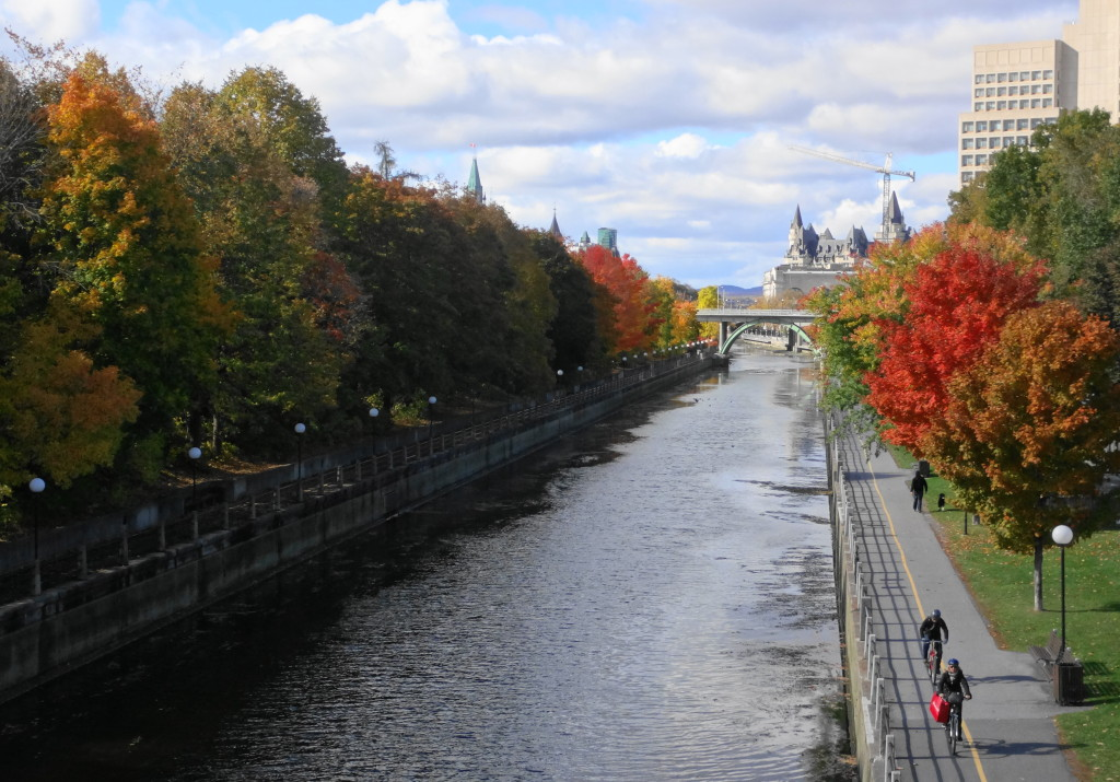 A view from the Corkstown Footbridge of the colourful trees lining the Rideau Canal.