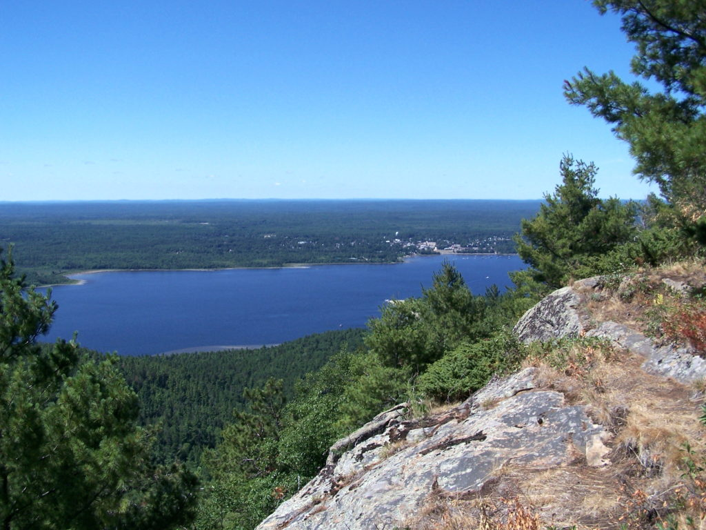 The Ottawa River and Ottawa Valley spread out below the lookout on Mount Martin, Quebec. In the distance, the town of Deep River lies along the far shore.