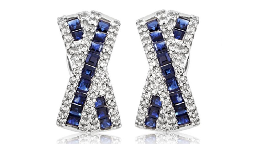 Exuding their regal nuance and intrinsic elegance against the marvelous backdrop of sparkling diamonds totaling 0.50ct, the gorgeous sapphires enrich the majestic design of these splendid 14K white gold earrings, weighing in total 2.50 carats.