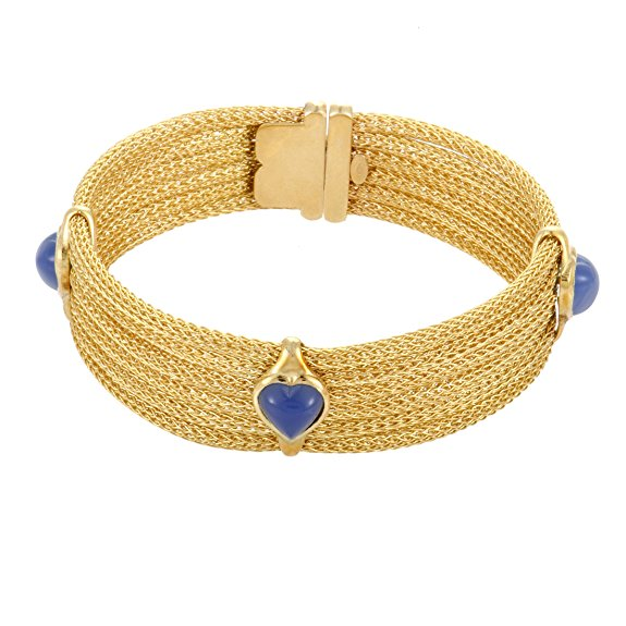 Scintillating, radiant and flamboyant, this fascinating bracelet is comprised of countless slim chains of precious 18K yellow gold to produce a mesmerizing visual effect while blue carnelian stones bring exceptional balance into the design.