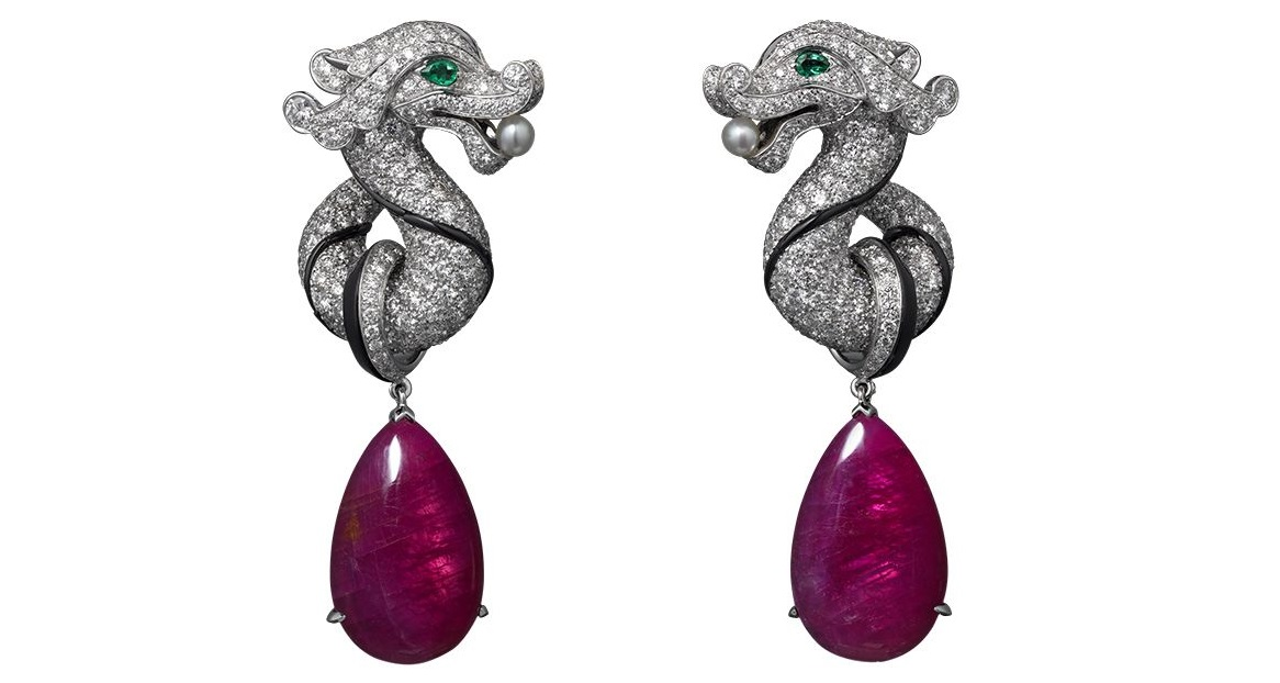 Cartier High Jewelry earrings White gold, two ruby drops totaling 21.47 carats, emerald eyes, two natural pearls, onyx, brilliants.