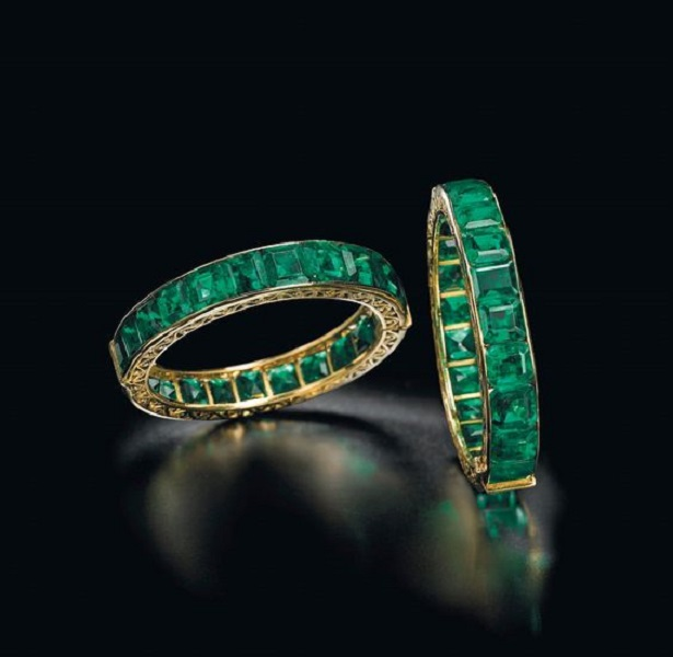 A pair of antique emerald Indian bangles