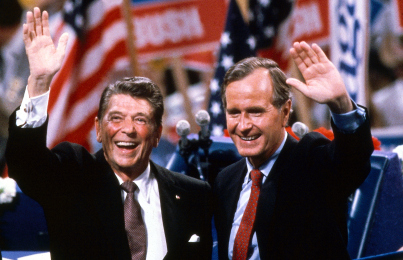 Republican Presidential nominee Ronald Reagan and Vice Presidential nominee George H.W. Bush embrace on the podium during the 1980 Republican National Convention at Joe Louis Arena. Detroit, Michigan