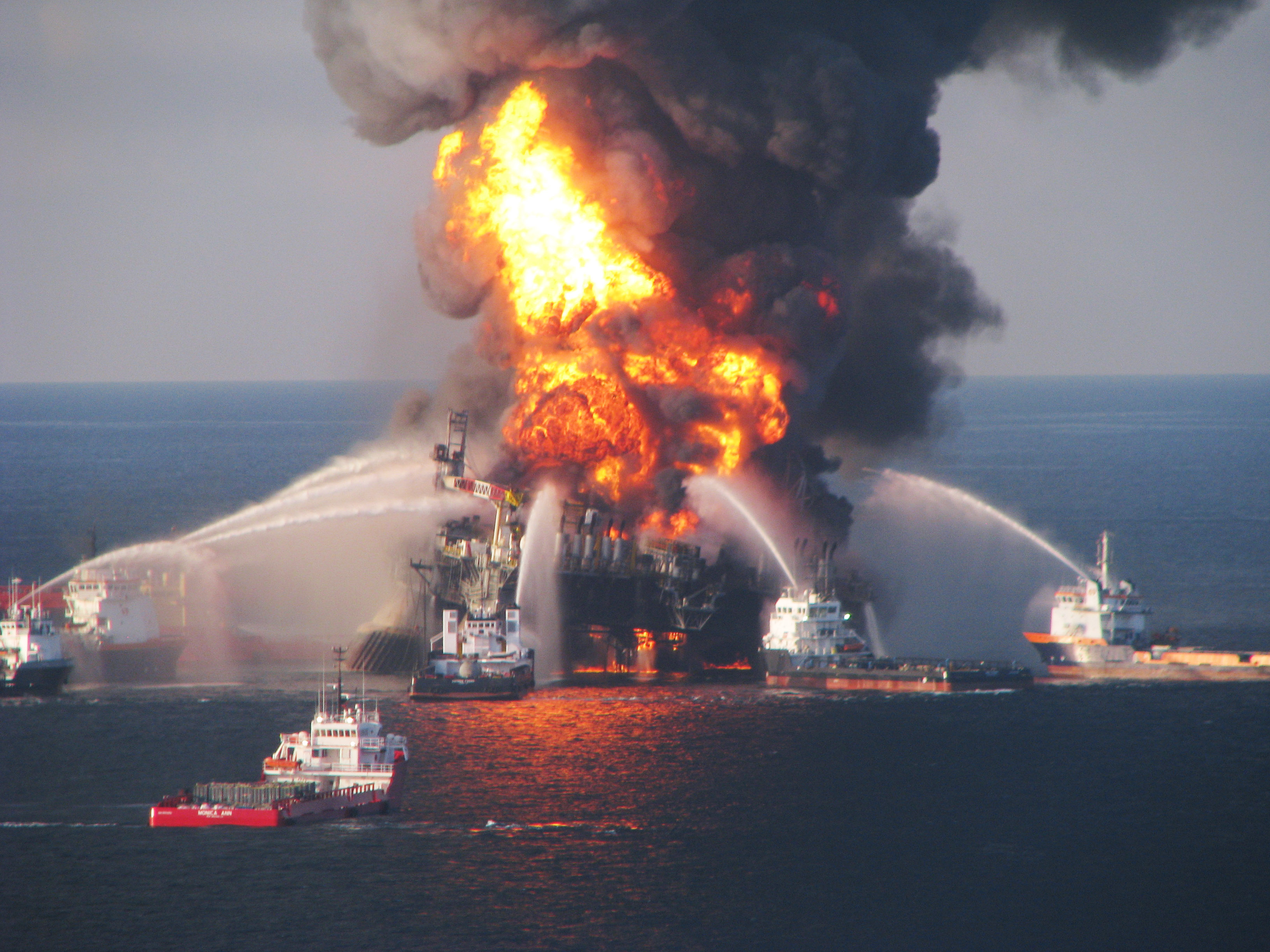 GULF OF MEXICO - APRIL 21: Fire boats battle a fire at the off shore oil rig Deepwater Horizon April 21, 2010 in the Gulf of Mexico off the coast of Louisiana. Multiple Coast Guard helicopters, planes and cutters responded to rescue the Deepwater Horizons 126 person crew after an explosion and fire caused the crew to evacuate. (Photo by U.S. Coast Guard via Getty Images)