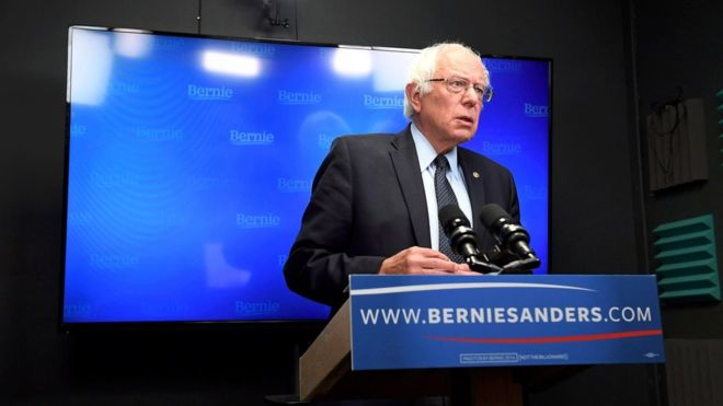 Bernie Sanders did not explicitly quit the campaign or endorse Hillary Clinton in the speech