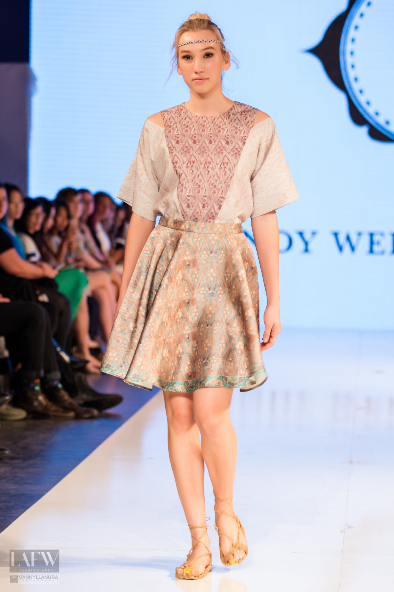 Model walks the runway in Cindy Wei Zhang design at Los Angeles Fashion Week SS17