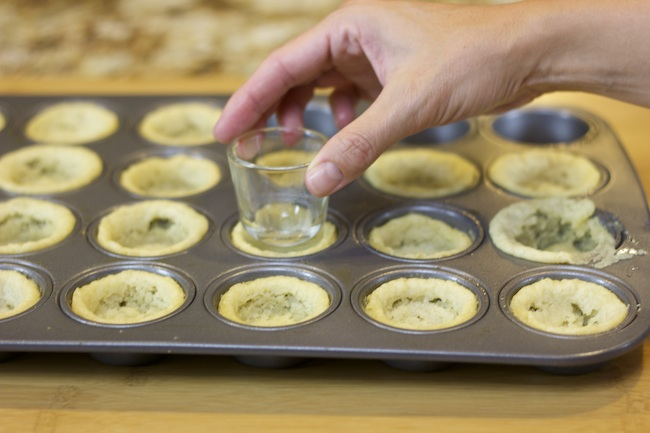 Make cookie cups with a muffin tin and cookie dough! Shape with a shot glass.