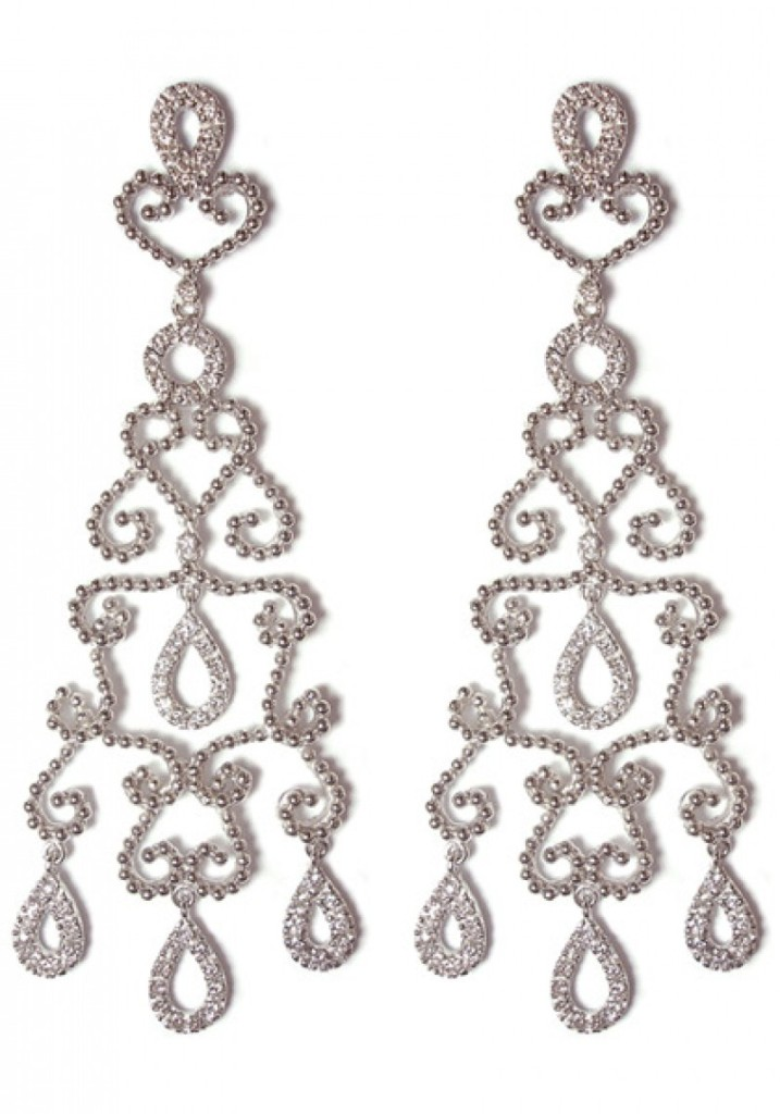 "Carla Amorim chandelier scroll earrings are in 18k white gold accented with petite diamonds. Earrings are 2.5"" in length and .75"" at their widest point, and have large post backs."