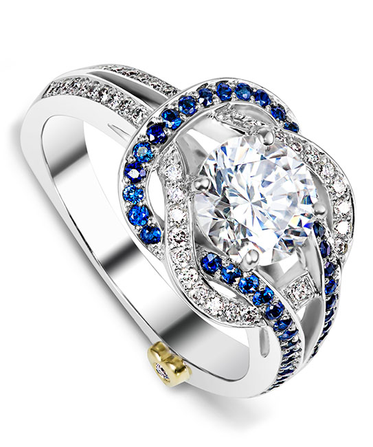 The Entangle engagement ring contains 49 diamonds totaling 0.245ctw and 41 sapphires totaling 0.205ctw. Center stone sold separately, not included in price. The Entangle wedding band contains 46 diamonds, totaling 0.23ctw.