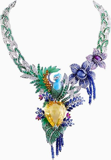 "One-of-a-kind Van Cleef Arpels ""Splendeur Africaine"" necklace featuring a 82.68-carat pear-shaped yellow sapphire, multi-color sapphires, emeralds, diamonds, chrysoprase and turquoise set in 18K white gold!"