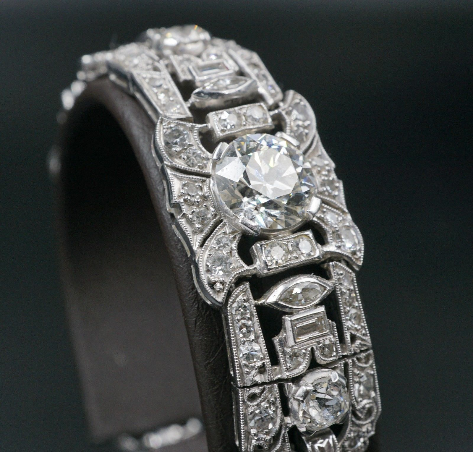 Bracelet: Edwardian era Art Deco design open filigree natural diamond link design, fastening with a fold-over locking clasp with safety chain | 205 diamonds | 8.91 carats |Appraisal: $110,500